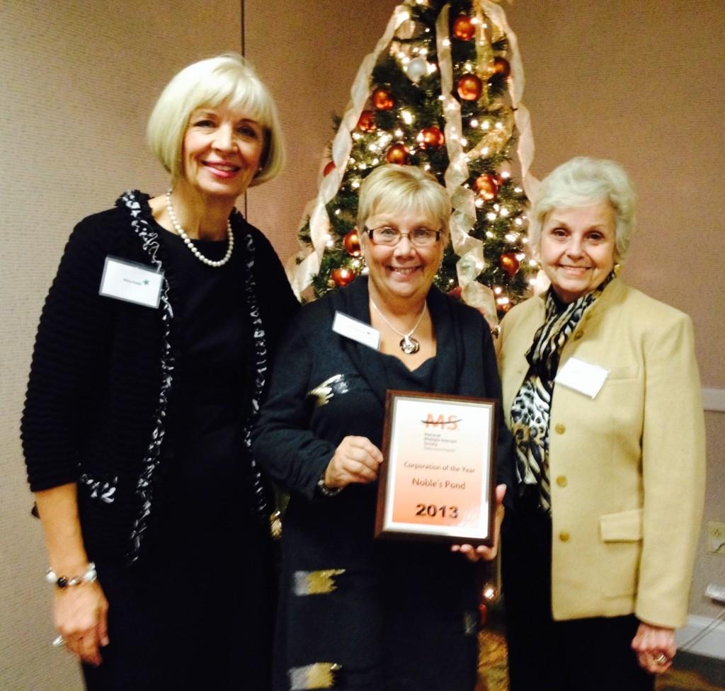 Mary Field, Colleen Ostafy, and Dorothy Carey accepting the award for 2013 Corporation of the Year  for Noble's Pond